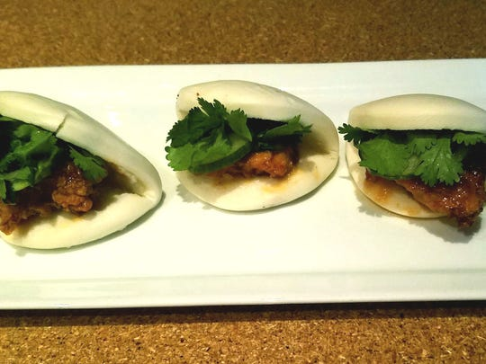 South Fork Kitchen and Bar's steamed buns were three  pillowy buns stuffed with chili glazed fried chicken, pickled cucumber, and fresh cilantro, accompanied by a zesty ginger aioli. Also known as a Bao, they are very trendy in modern eateries across the country.