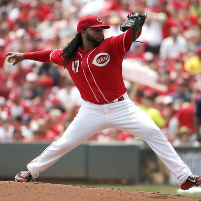 Reds starting pitcher Johnny Cueto delivers in the