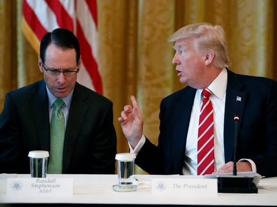 "AT&T CEO Randall Stephenson listens as President Trump speaks during the ""American Leadership in Emerging Technology"" event in the East Room of the White House June 22, 2017."