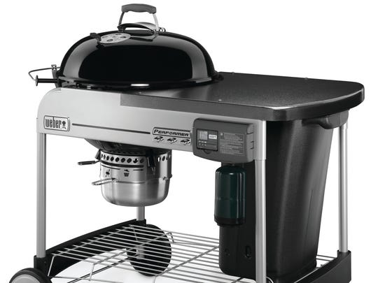 You could win this Weber Performer Deluxe Charcoal Grill.