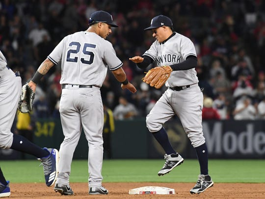 Apr 28, 2018; Anaheim, CA, USA; New York Yankees shortstop Gleyber Torres (25) and second baseman Ronald Torreyes (74) celebrate after defeating the Los Angeles Angels at Angel Stadium of Anaheim.