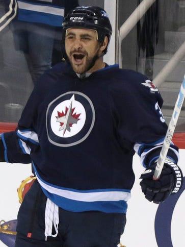 Winnipeg Jets defenseman Dustin Byfuglien celebrates