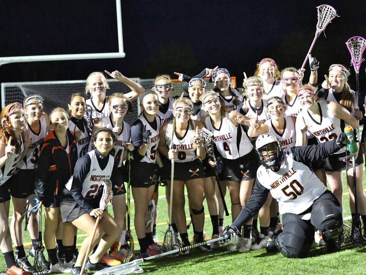 The Northville girls lacrosse team celebrates after winning the Kensington Conference title with a 10-5 win at Novi.