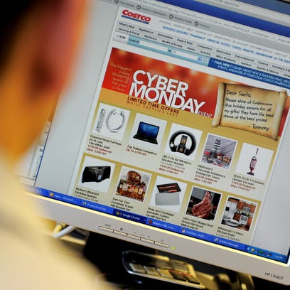 An office worker looks at Cyber Monday specials on