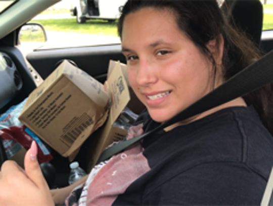 Romelia Guerra of Fort Myers said the food she collected