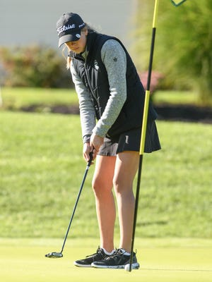 Kristen Belden of Central Catholic hits a birdie putt on the 11th hole during the 2020 Stark County Girls Golf Invitational at The Sanctuary Golf Club on Saturday.
