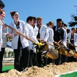 Southern Miss nursing students turn dirt at the groundbreaking ceremony for Asbury Hall, the future home of the College of Nursing on campus. The $31-million facility is slated for completion in 2016.