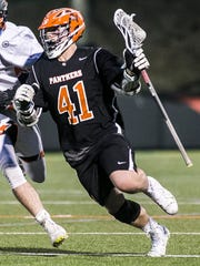 Kollin Vaught (41), seen here in action during the high school season for Central York. Vaught may be the best face-off man in the York-Adams League. YORK DISPATCH FILE PHOTO