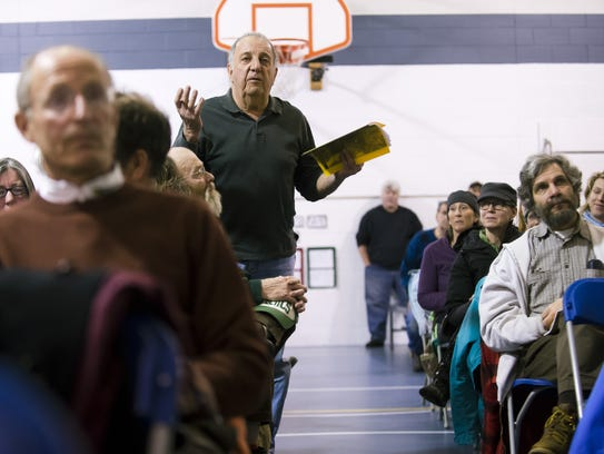 A Bolton resident questions per-student costs during the School Board's portion of Bolton's town meeting in March 2013.