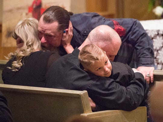 Family members comfort each other before a memorial service for Cody Risk at Bohlender Funeral Chapel on Thursday, February 8, 2018. Risk, 26 from Wellington, is among five people killed in an oil rig explosion near Quinton, Oklahoma.
