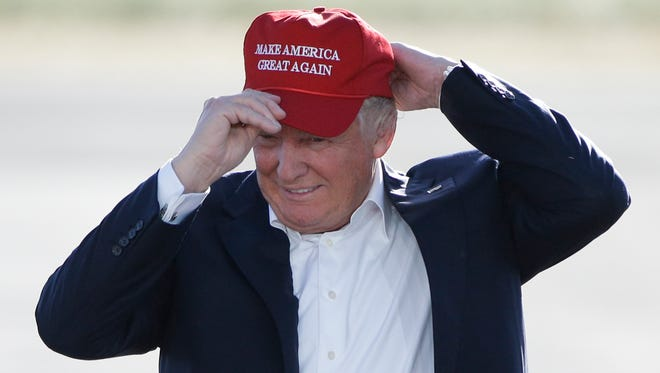 "In this June 1, 2016, file photo, Republican presidential candidate Donald Trump wears his ""Make America Great Again"" hat at a rally in Sacramento, Calif."