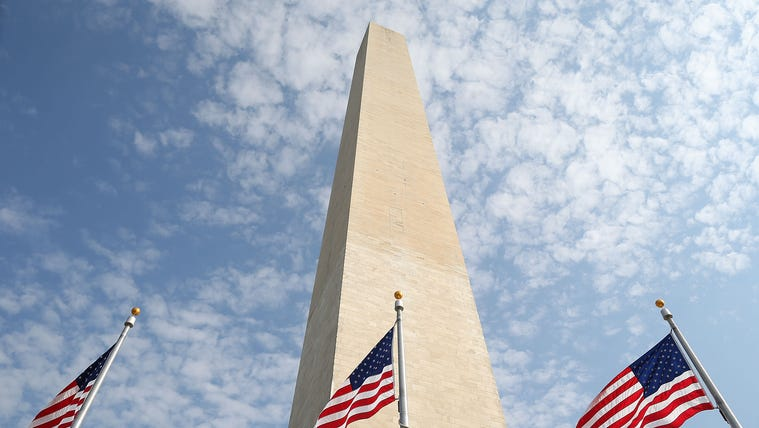 American flags circle the Washington Monument on the National Mall on September 26, 2012.