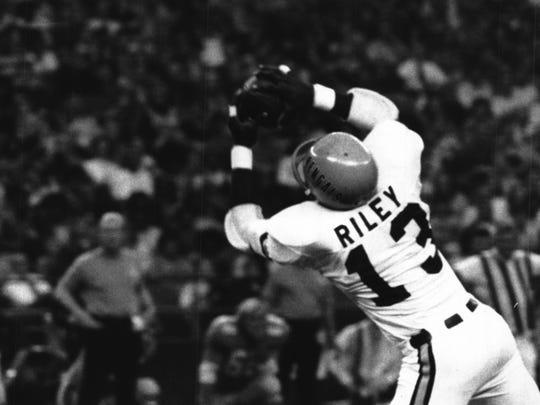 From Nov. 1, 1971: Ken Riley clamps onto an interception, one of two for him and one of four by the Bengals against Houston.