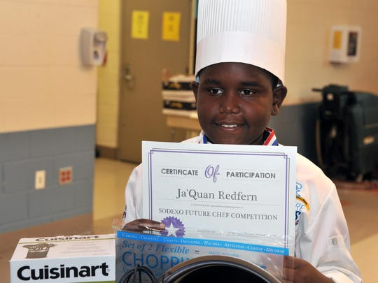 Future chef competition winner Ja'Quan Redfern poses with his winnings, Wednesday, Mar. 16, 2016.
