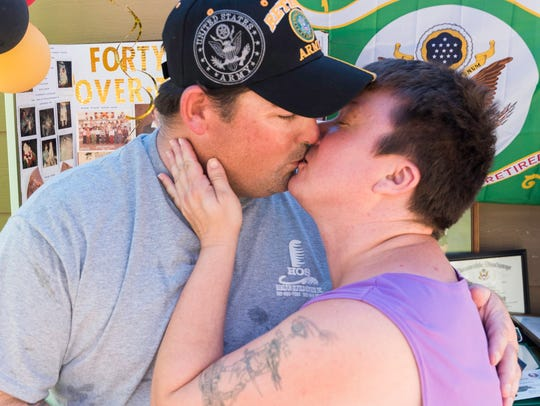 Darlene and Jeffrey Fleming enjoy a quick smooch to