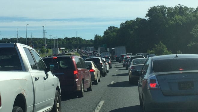 A disabled tractor-trailer has traffic significantly backed up Tuesday morning.