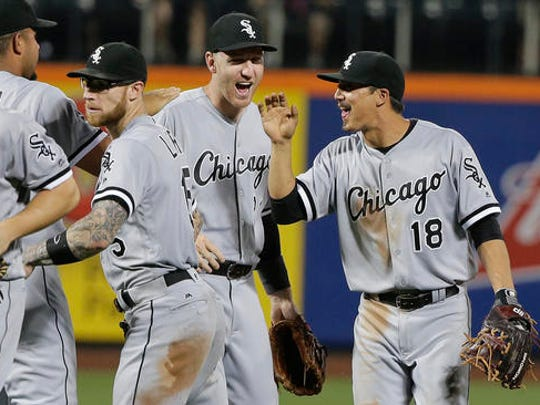 Toms River native Todd Frazier (center) of the Chicago White Sox celebrates a win keyed by his two-run home run against the Mets at Citi Field
