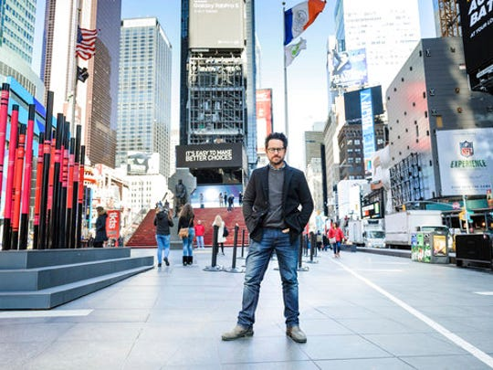 """In this March 2, 2017 photo, director-producer J.J. Abrams poses for a portrait to promote """"The Play That Goes Wrong"""" in Times Square in New York."""