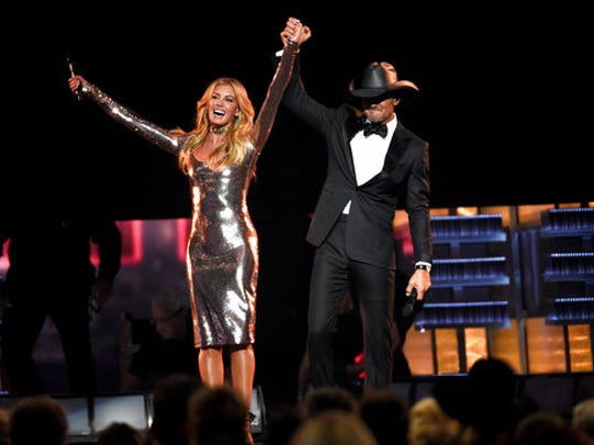 "FILE - In this April 2, 2017 photo, Faith Hill, left, and Tim McGraw appear after a performance of  ""Speak To A Girl"" at the 52nd annual Academy of Country Music Awards in Las Vegas. The country couple with movie star glamour has sold over 63 million albums in the U.S. between their two careers, has earned two Grammys for duets they sang together and has three children. This year, they are releasing their first-ever duet album together and started their third installment of their highly successful Soul2Soul World tour on April 7."