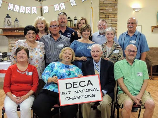 Eleven of the 15 DECA students who won the national championship, along with their typist, attended the 40th reunion.