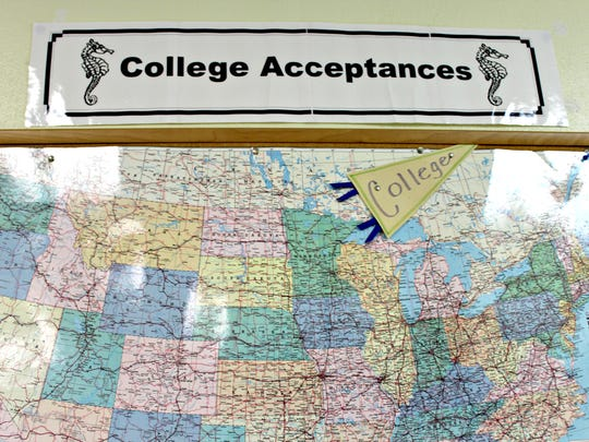 A college acceptance map hangs inside the Burlington High School guidance office on Wednesday, Dec. 14, 2016. The school's transition to proficiency-based learning has prompted concerns from students and parents about the impact on college admissions.