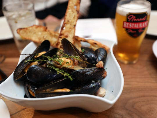 """The """"Beer Muscles"""", PEI mussels steamed in beer and bacon, at the Nanuet Restaurant on Main Street in Nanuet, May 29, 2018."""