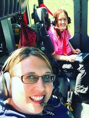 Volunteer EMTs Anne Lynch and Misty Walker of the Verona Volunteer Fire Company on their way back from responding to a call.