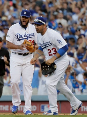 Dodgers relief pitcher Kenley Jansen, left, and first baseman Adrian Gonzalez celebrate the team's 6-5 win over the Washington Nationals in Game 4 of the National League Division Series in Los Angeles.