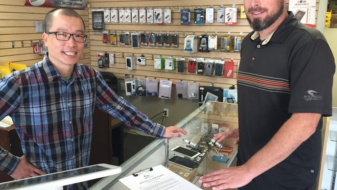 Ae Khamsouk and Josh McClain, owners of Central Valley iRepair, take a break from helping customers on April 1, 2015 at their repair shop, 1307 S. Mooney Blvd. The partners remedy a number of phone and computer problems while promoting recycling.
