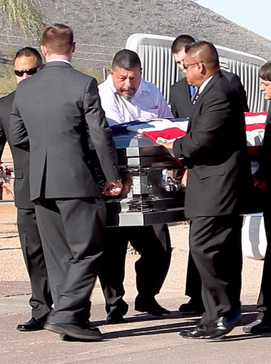 """Friends and family of Ernest """"Marty"""" Atencio attend his funeral at the National Memorial Cemetery of Arizona in Phoenix on Jan. 4, 2012.  Atencio died after being stunned with a Taser at a county jail in December 2011."""