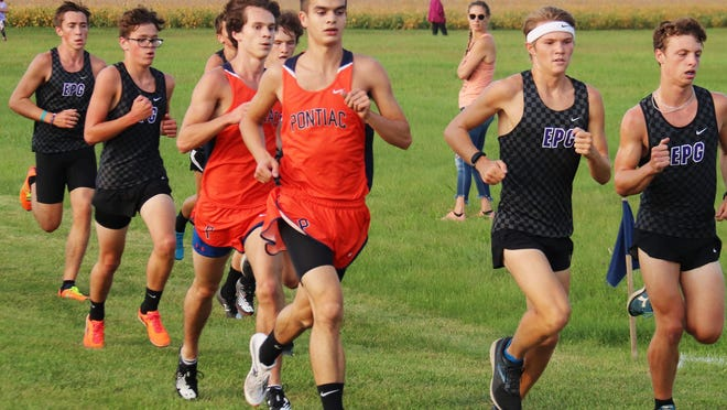 Pontiac's Aidan Lee leads teammate Sam Fogarty as the duo are surrounded by a pack of El Paso-Gridley Titans during Tuesday's cross country meet at the Rec-Plex. Lee won the boys race but EPG won the team event.