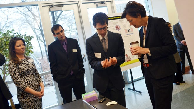 Alex Brown, a University of Iowa biomedical engineering student, demonstrates a prototype for a ophthalmology suture extractor to Iowa Lt. Gov. Kim Reynolds on Wednesday at the Seamans Center.