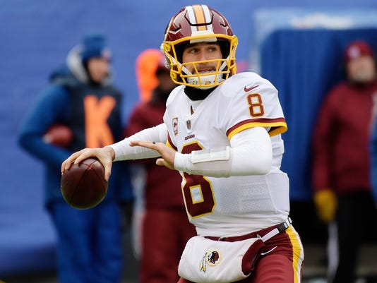 """FILE - In this Dec. 31, 2017, file photo, Washington Redskins quarterback Kirk Cousins (8) throws a pass during the first half of an NFL football game against the New York Giants in East Rutherford, N.J. Cousins says he is likely to wait until March for any possible negotiations with the Washington Redskins, indicating he would first make the team decide whether to apply a transition or franchise tag on him for the third year in a row. Appearing at a fan forum aired live on 106.7 The Fan, the local radio station on which the quarterback makes weekly regular-season appearances, Cousins said Friday, Jan. 5, 2018, he believes the Redskins are """"all-in"""" on trying to sign him to a long-term contract. (AP Photo/Bill Kostroun, File)"""