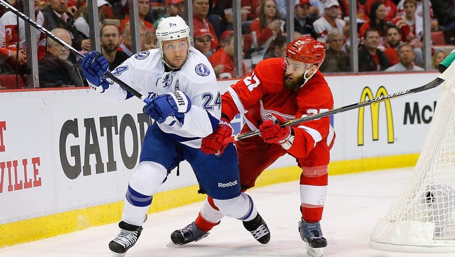 Ryan Callahan, left, of the Tampa Bay Lightning and Kyle Quincey of the Detroit Red Wings battle during Game 3 on Tuesday, April 21, 2015, at Joe Louis Arena in Detroit.