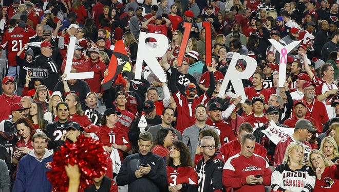Cardinals fans cheer for Larry Fitzgerald  following the Cardinals  win over the  Green Bay Packers  in  their divisional playoff game Saturday, Jan. 16, 2016 in Glendale, AZ