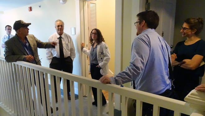 Michael Chesler, developer, left, talks to Dr. John Fortney, Chief Medical Officer for Adena Health System, and medical students that will live in the building Gabrielle Pugliese, Nicholas Elwert, and Sara Hromadka on the fourth floor during a tour Tuesday in the Carlisle building.