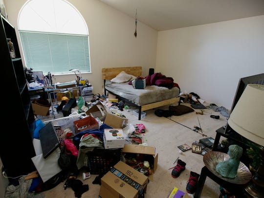 Toys and other items are strewn around one of the bedrooms