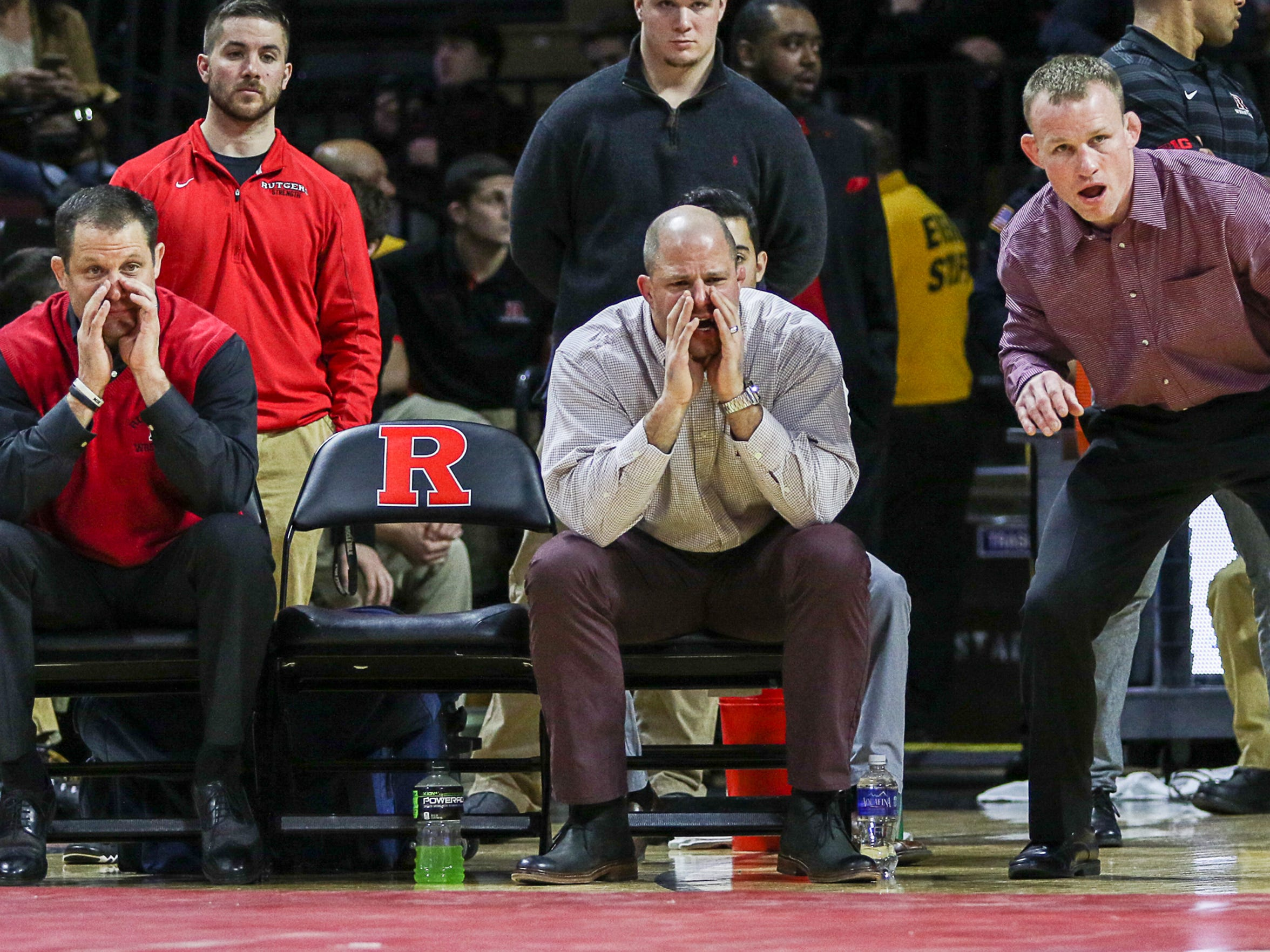 Rutgers coach Scott Goodale, assistant coach John Leonardis and associate head coach Donny Pritzlaff, pictured left to right, helped wrestling climb to a No. 6 national ranking this season.