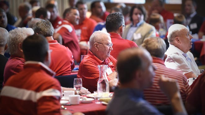 Former St. John's University head football coach John Gagliardi listens as current coach Gary Fasching speaks Friday during the annual football kickoff luncheon at Sexton Commons in Collegeville.