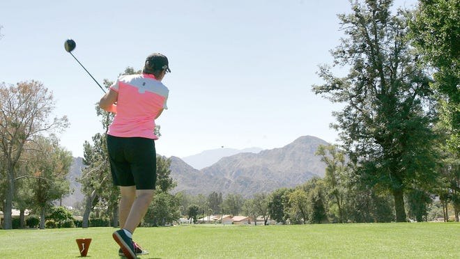 Joan Busch of Vancouver Island, Canada, hits a drive on the 12th hole at Palm Desert Country Club in 2012. Desert Sun file photo.