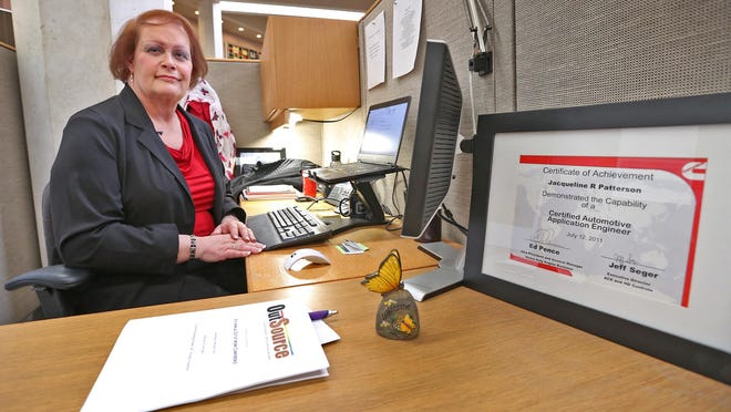 Jacqueline Patterson, seen in her office at Cummins Inc. in Columbus on Feb. 24, 2015, received the Certificate of Achievement at right when she was a man. When she returned to work after her transition to a woman, the certificate was on her desk with her new name.