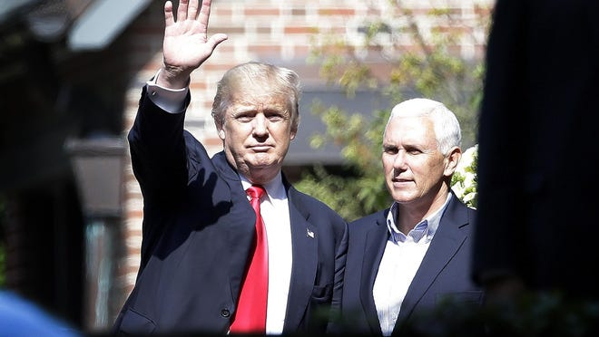 Republican presidential candidate Donald Trump waves to media after meeting with Indiana Gov. Mike Pence at the Governor's Residence on July 13, 2016.