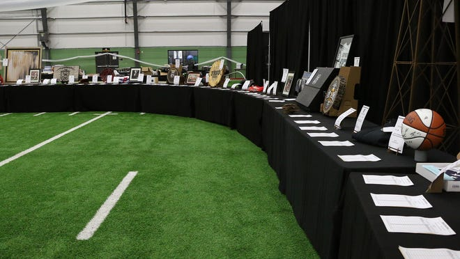 One of the tables of silent auction items at last year's Tiger Athletic Auction at the Schmidt-Bickle Training Facility.