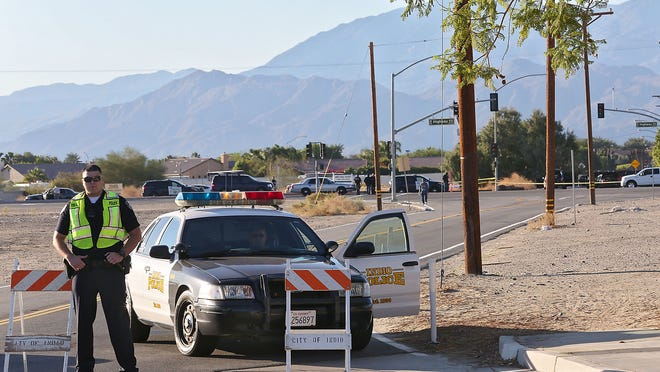 Jay Calderon/The Desert Sun Indio police have a large area of Indio cordoned off Monday as they investigate a shooting near the intersection of Highway 111 and Shields Road. Indio police have a large area of Indio cordoned off as they investigate an officer involved shooting near the intersection of Hwy 111 and Shields Rd, Monday, November 3, 2014.