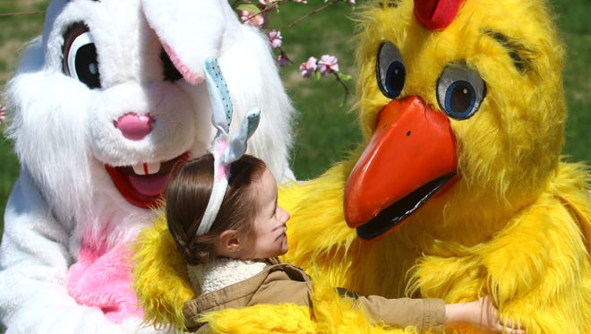 Lily Richlovsky, 4, hugs the Spring Chicken before the start of the 26th annual Easter Egg Hunt at Dayspring Assisted Living on Saturday, March 26, 2016.