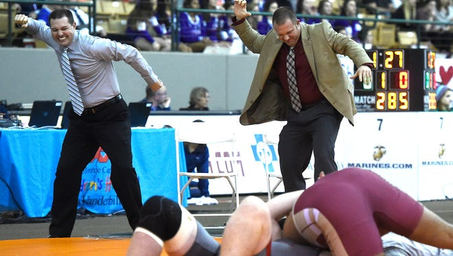 Riverdale coaches including Shawn Jones, right,  celebrate before the pin is finished as they knew Nick Boykin was going to defeat Jefferson County's Logan Townsend at the  TSSAA State Wrestling Championships on Saturday in Franklin.