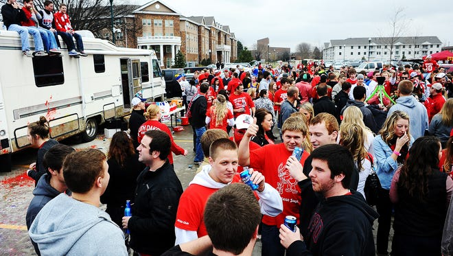 Football fans mingle during a tailgate party before a game between USD and SDSU in 2013. The South Dakota Board of Regents is considering a proposal to allow colleges to sell alcohol at certain events, including sports.