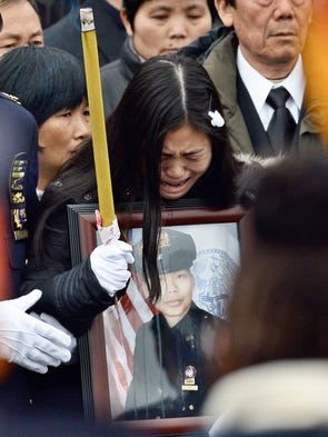 Pei Xia Chen, widow of New York Police Department officer