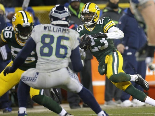 Packers cornerback Damarious Randall looks for room to run after intercepting a pass against Seahawks quarterback Russell Wilson.