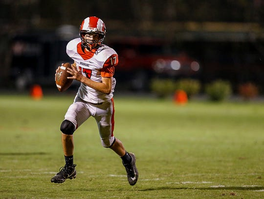 Manual QB Zach Recktenwald (17) looks up field on the